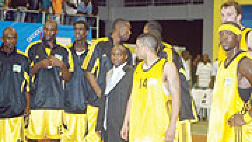 The team relaxes after the final game of Zone 5 Championshiop against Egypt early this year in Kigali. Rwanda opens  its campaign agaist Morocco  this evening. (File photo)