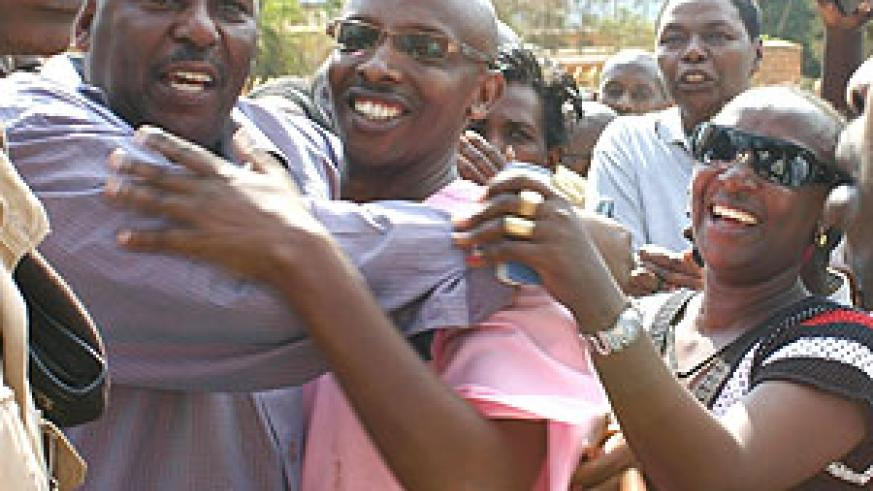 Frank Kalisa being congratulated by friends and relatives outside court yesterday after his release. (Photo by F. Goodman)