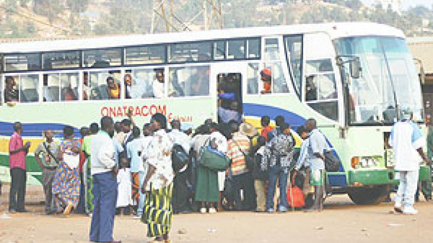 BACK TO SCHOOL:  Students hustle to enter an ONATRACOM bus as they get back to school yesterday.(Photo/F Goodman)