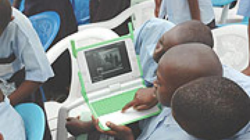 Primary School boys try to surf the Internet with one of the Laptops given to them. (File Photo)
