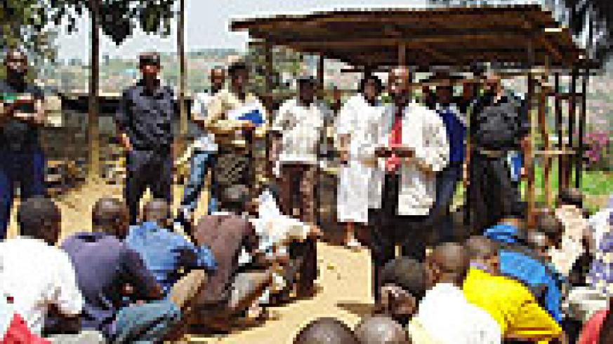 Hon Theobald Mporanyi and other district officials speak to inmates at Nyamabuye Police Station(Photo D.Sabiiti).