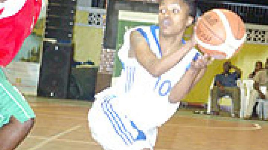 Rwanda's top female basketball players Honore Ayebare does her tricks against Burundi during the Zone 5 championship early this year. The national team has started early preparations for the continental event.