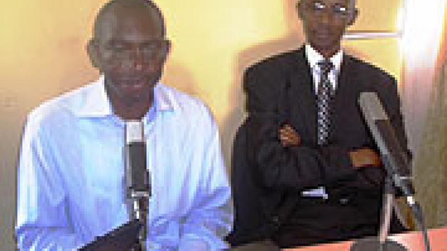 The Mayor of Rwamagana Valens Ntezirembo (R)and Willy Rukundo (L) in the Studio at the official lauch. Photo S Rwembeho