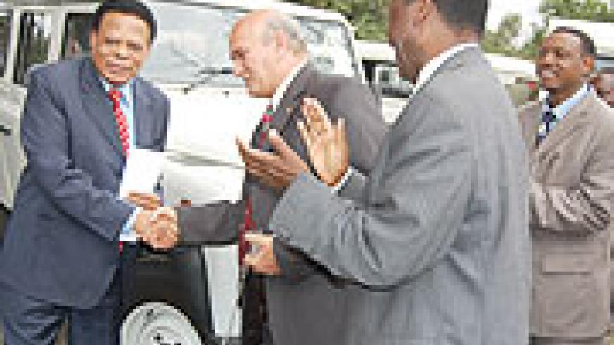 EAC Secretary General Juma Mwapachu receives the vehicles from Suresh Nathwani, the branch manager of CMC Automobiles in Arusha yesterday. (Courtsey Photo)