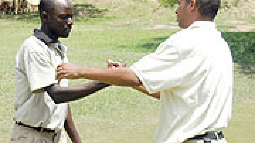 Emmanuel Ruterana (L) being congratulated by one of his opponents after winning the 2007 edition of Rwanda Open.