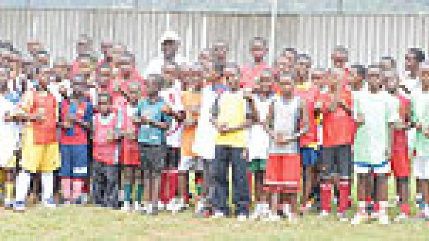 FOR THE FUTURE:  APR academy players pose for a group photo. At the back row in cap is their coach Rene Kalimunda. (file photo)