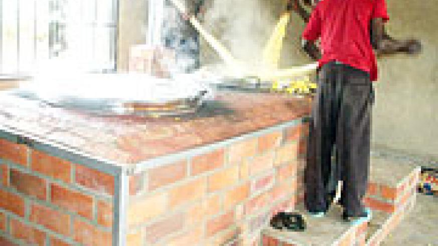 Cooks at Mayange Primary School: The improved stove provides cleaner air for everyone.