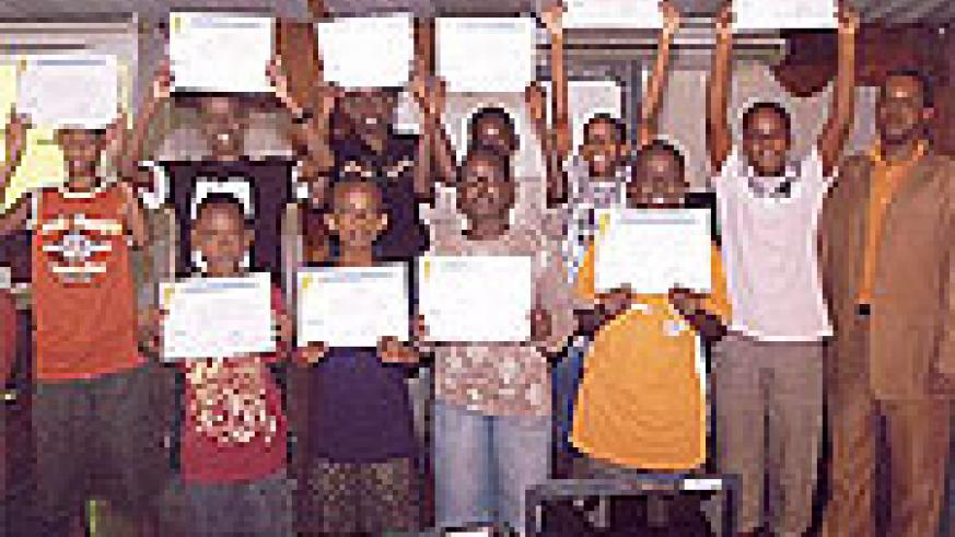 A group of Rwandan teens show their certificates after training on Visual Basic in Kigali recently.