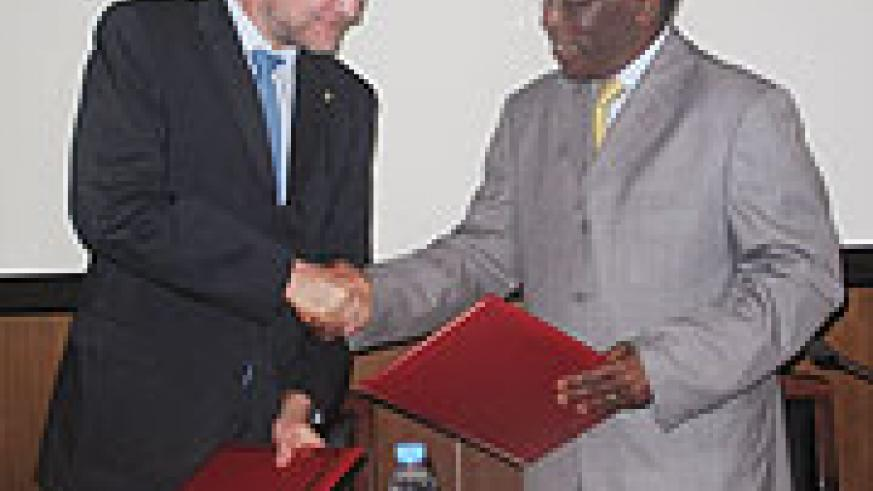 Eugène Munyakayanza and Niels Breyer shaking hands after signing a cooperation agreement at the end of the meeting yesterday (Courtesy Photo).