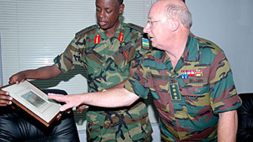 Rwanda's CDS Gen. James Kabarebe (L) admires a gift from his Belgian counterpart Gen. Charles Henri Delcour at the Ministry of Defence Yesterday. (Photo J Mbanda)