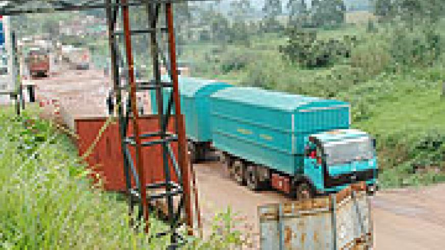 CHANGING LANES: A transit goods truck crosses into Rwanda through Gatuna. Local importers have threatened to stop using Dar es Salaam to import goods.