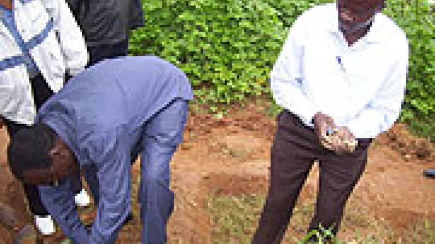 Mayor Justus Kangwagye (Right) participating in tree planting campaign at Yanze watershed recently. (Photo A Gahene)
