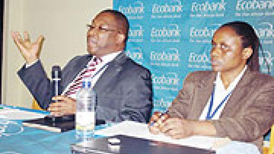 Clement Dodo,(R)  the Executive Director of Ecobank, the Pan African Bank in Rwanda, and Muhanga Branch manager, Solange Ingabire. Photo / D. Sabiiti)