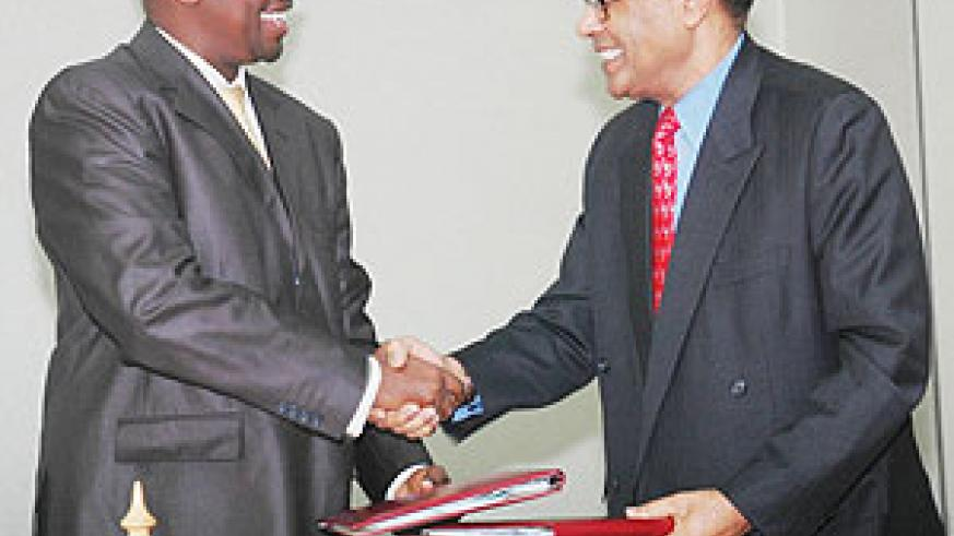 Finance Minister James Musoni and C.E.O Investment Climate Facility for Africa Omar Issa after signing. (Photo J Mbanda)