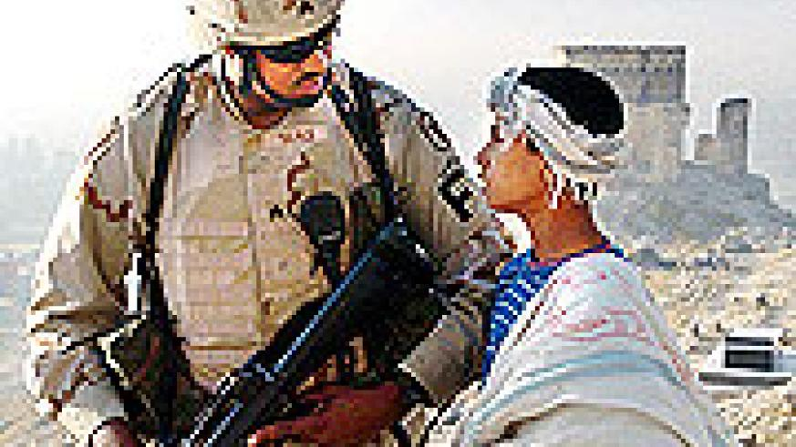 A US soldier chatting with an Afghan youth in Kandahar Province, Southern Afghanistan.