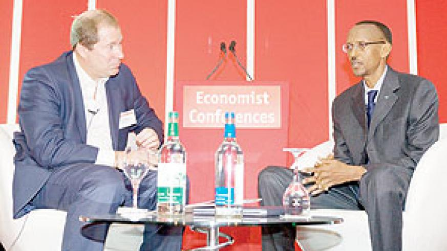 President Kagame is interviewed by Richard Cockett, Economist's Africa Editor, at the Economist Conference  in London. ( Photo Urugwiro Village)
