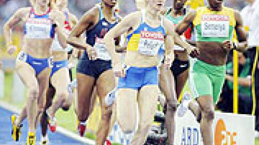 Caster Semenya leading the field in the Berlin Athletics Championships. Her gender status has caused a furore in South Africa.
