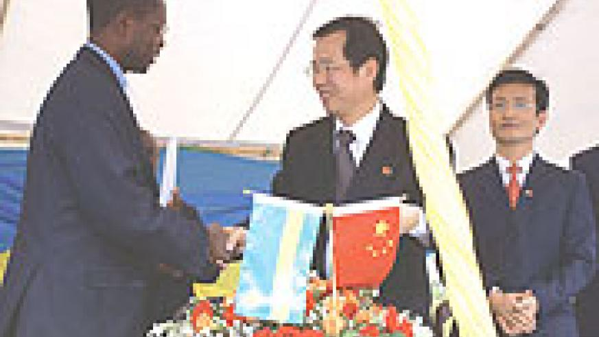 Chinese Ambassador handing over the school keys to state Minister for Primary and Secondary Education, Dr. Mathius Harebamungu.