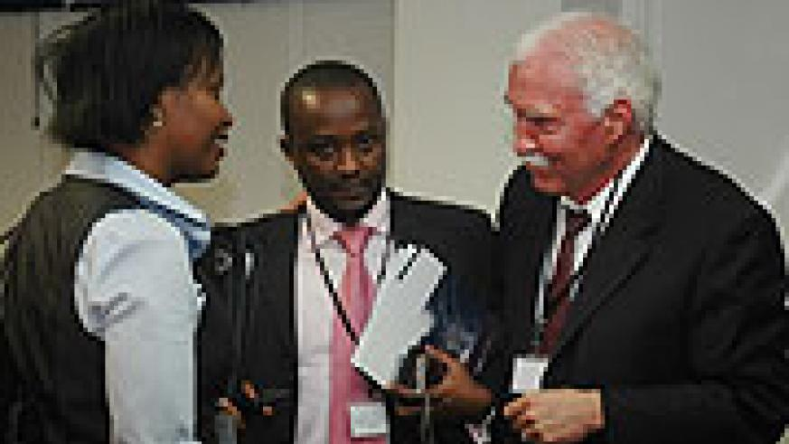 RDB officials Clare Akamanzi, Frank Twagira and Joe Ritchie during the launch of 2010 Doing Business Report. (File Photo)