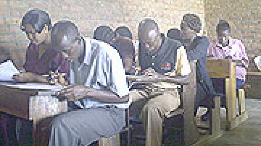 Teachers sitting for English examinations at Group Scholaire de Kibuye yesterday. (Photo: S. Nkurunziza)