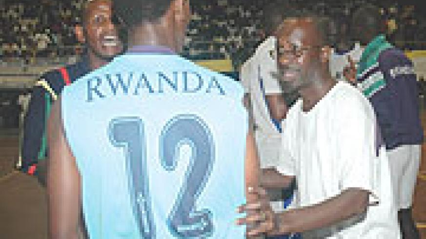 Jean Marie Nsengiyumva (R) talks to one of his players during Sunday's Coupe du Rwanda final against APR. KVC won the contest 3-1. (Photo/ F. Goodman)