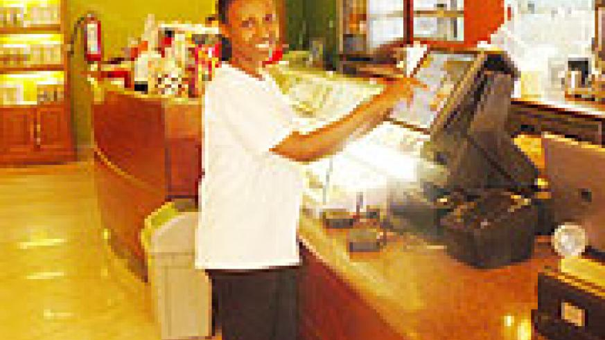 A waitresses using a modern machine that keeps count of the customers' orders.