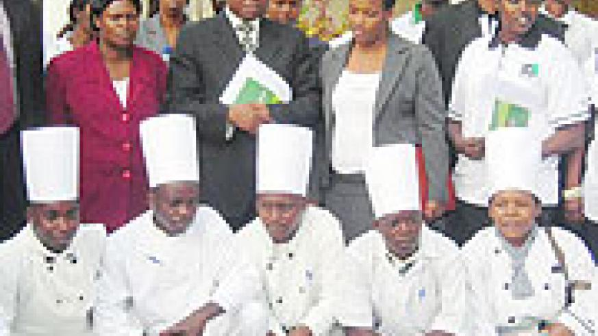 Chefs from different hotels pose for a group photo with the organisers of the hospitality industry training. (Photo: B. Mukombozi)