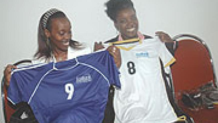 (L) Dr. Diane Gashumba and Sandra Idossou, proudly showing off the jerseys women will wear during the match. (Photo/ J. Mbanda)