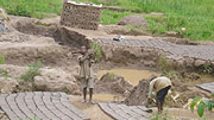 Under age children who are  used as a form of  cheap labour in brick making enterprises in Muhanga-Photo D.Sabiiti