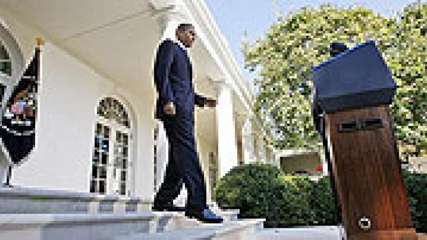 President Obama arrives in the Rose Garden of the White House in to speak about winning the 2009 Nobel Peace Prize.