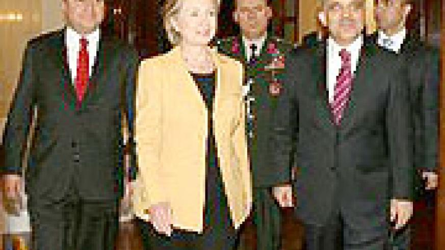 Secretary of State Hillary Clinton with President Abdullah Gul (right) and Foreign Minister Ali Babacan, left on March 7.
