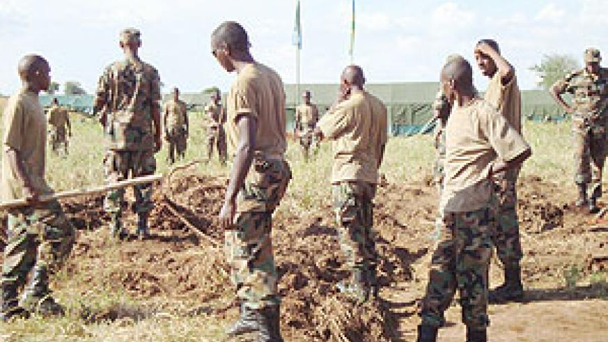 RDF forces engage in a cleaning exercise upon their arrival in Kitgum, Northern Uganda    (Courtesy Photo)