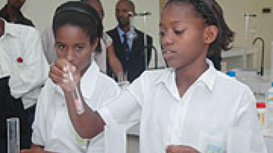 Students of Glory Secondary School making demos in the new school lab after it was opened yesterday. (Photo/ F Goodman)