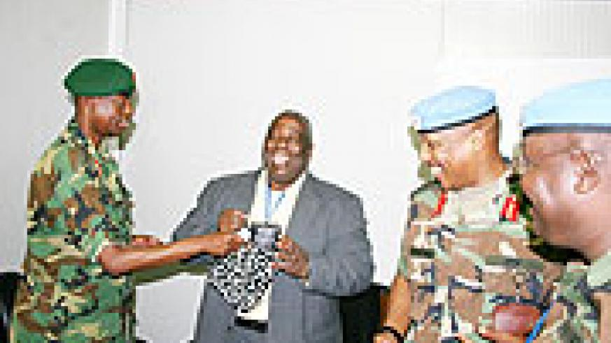 Gen James Kabarebe with Henry Anyindoha  UNAMID Joint Special Representative after their meeting yesterday, right is UN force Commander Gen. Patrick Nyamvumba  (Photo C. Gankuba)