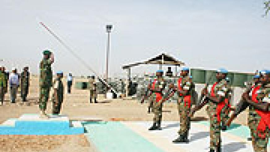 Gen Kabarebe takes the salut in Darfur yesterday. (Photo RDF)