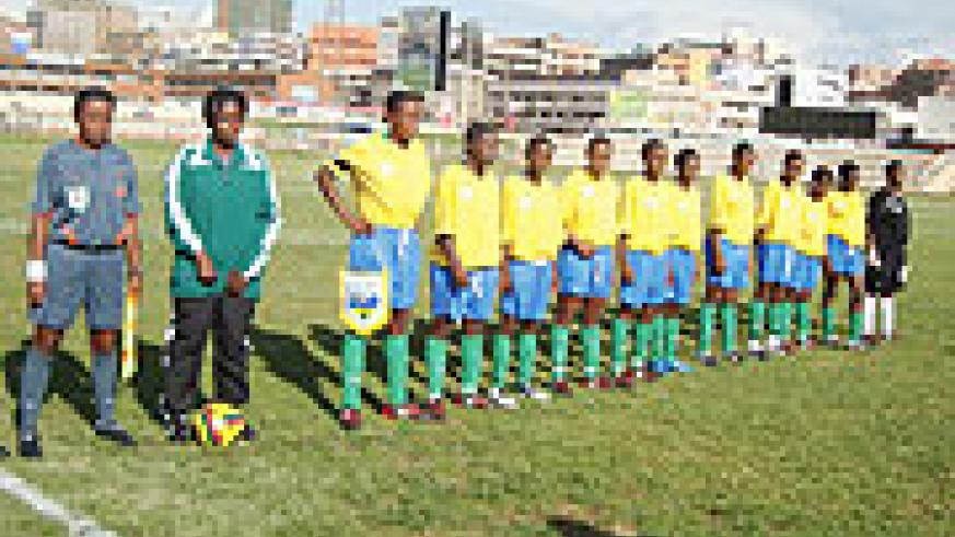 The national U-20 women team pose for  group photo before Saturday's clash with their Ugandan counterparts on Saturday. (Photo/ E. Kabera)