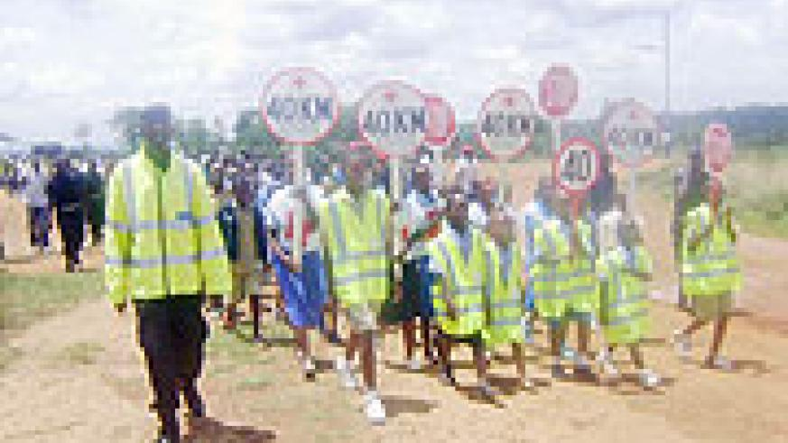 Police leads pupils  in the road safety campaign.(Photo: G. Mugoya)