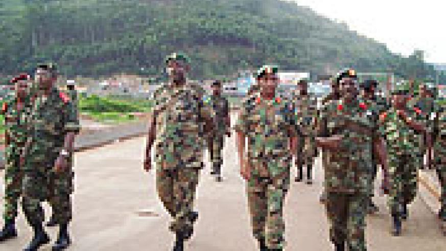 RDF and Burundian troops crossing the border at Gatuna from joint exercises by EAC member states.