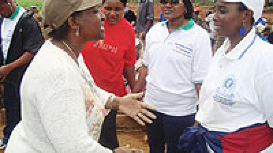 Foreign affairs Minister Rosemary Museminali chats with other government officilals shortly after Umuganda on Saturday