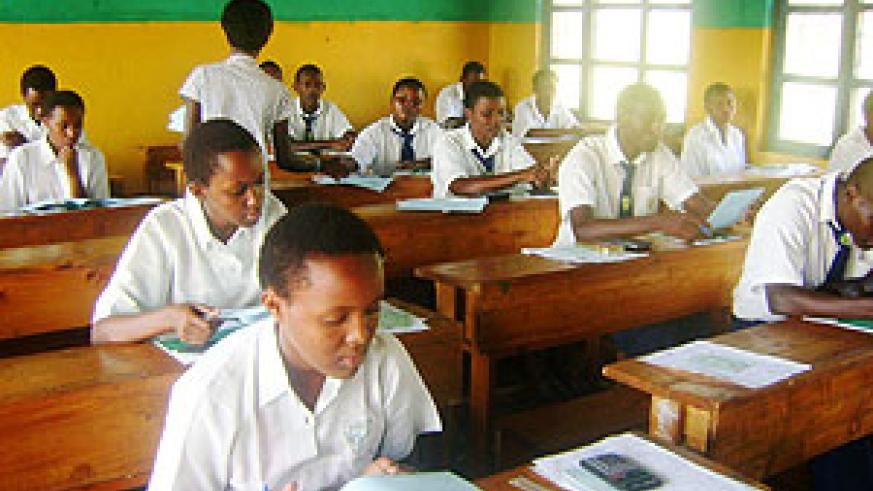 Students taking exams within one of the centers. (Photo: S. Rwembeho)