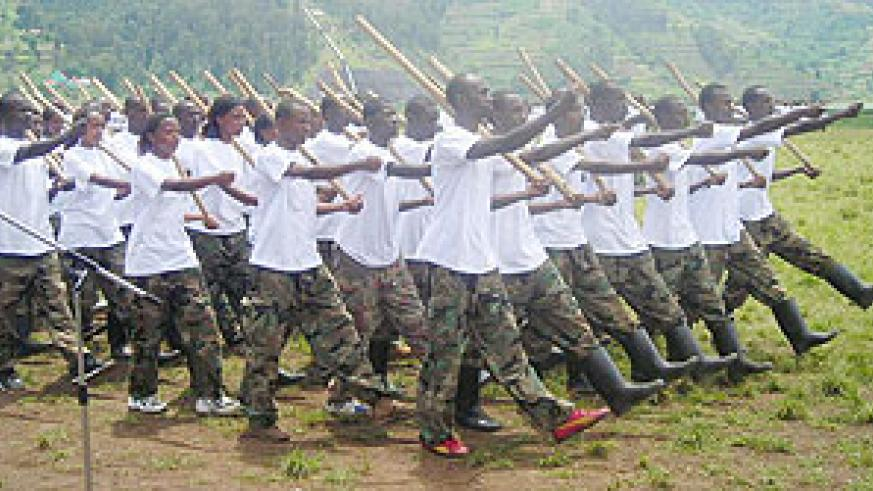 Students march during pass-out after completing ingando. (Photo: B. Mukombozi)