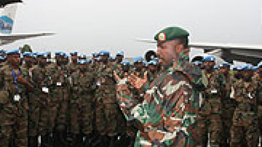 Chief of Staff Land Forces Lt. Gen Charles Kayonga addressing the RDF soldiers upon arrival at Kigali International Airport last evening.