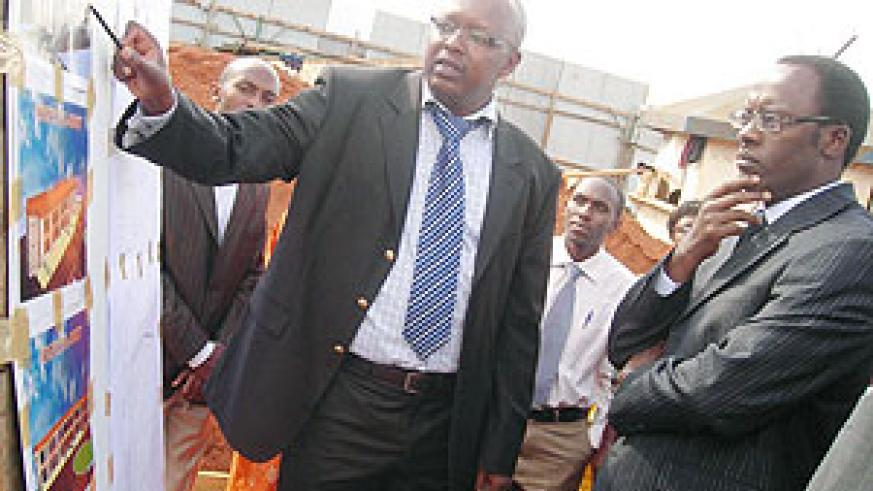 Governor  Fidele Ndayisaba (R) being briefed about the complex by a cooperative member. (Photo: P. Ntambara)