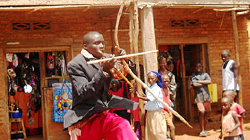 A self styled musician in Bugesera town entertains strangers all the day, only to spend his earnings at a bar.