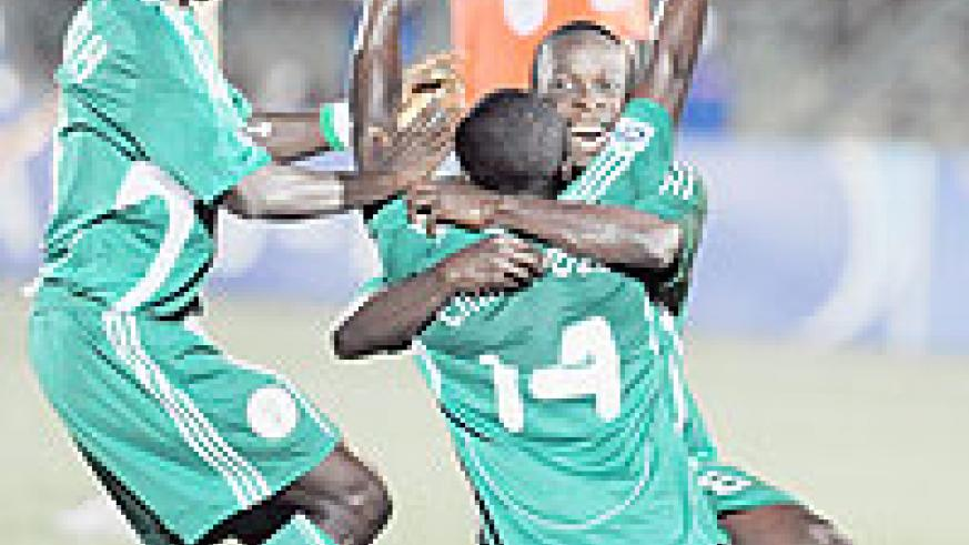 Nigerian players celebrate the second goal during the second semi final of FIFA U-17 World Cup against Spain in Lagos