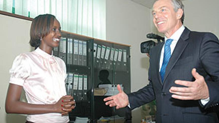 Tony Blair chats with an RDB employee during his tour