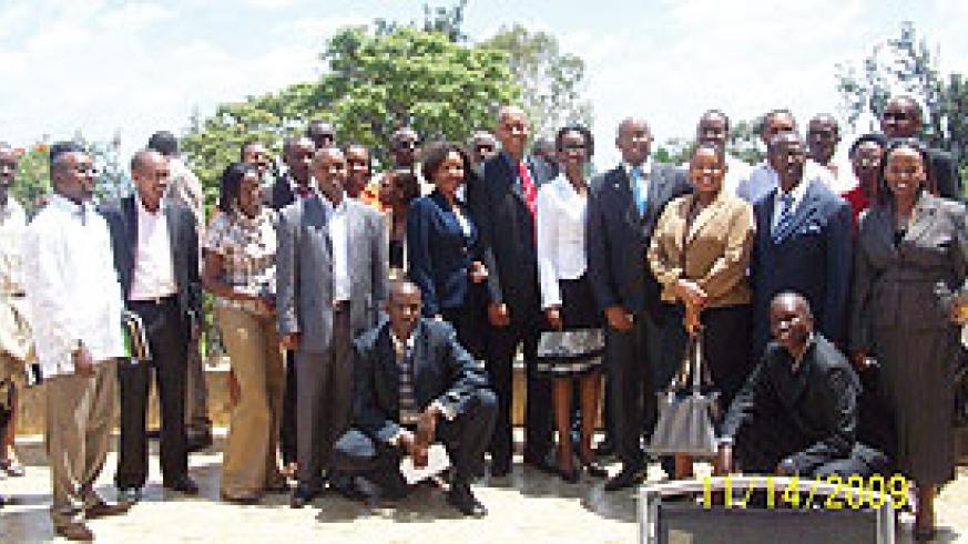 Some of the JCI members posing for a photo with the new and outgoing committes. (Photo/ B. Asiimwe)