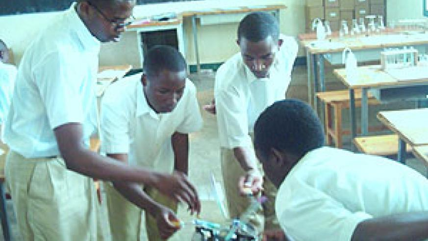 Candidates doing Chemistry practical exams at Groupe scolaire Officiel de Butare. (Photo/ F Ntaweukuriryayo)