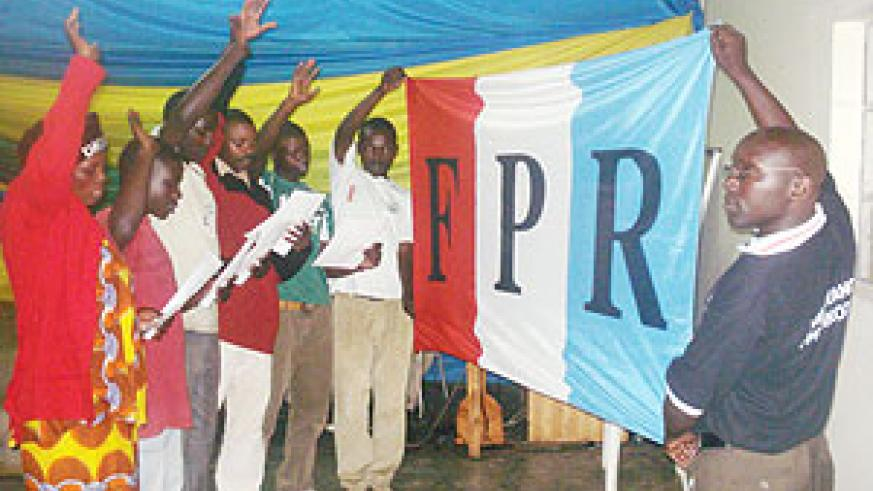 Samuel Hatangimana (R), the Atraco RPF special cell chairman  administers an  oath to the new members.