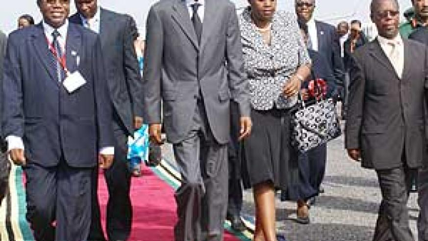 President Kagame arrives in Arusha for the EAC Summit yesterday. He is flanked by Rwanda's Ambassador to Tanzania, Fatuma Ndangiza, and John Chilligati, Tanzania's Minister for Urban Planning. (Photo Urugwiro Village)